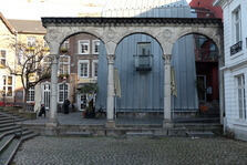 Photo of the arcade arch at the court in Aachen.